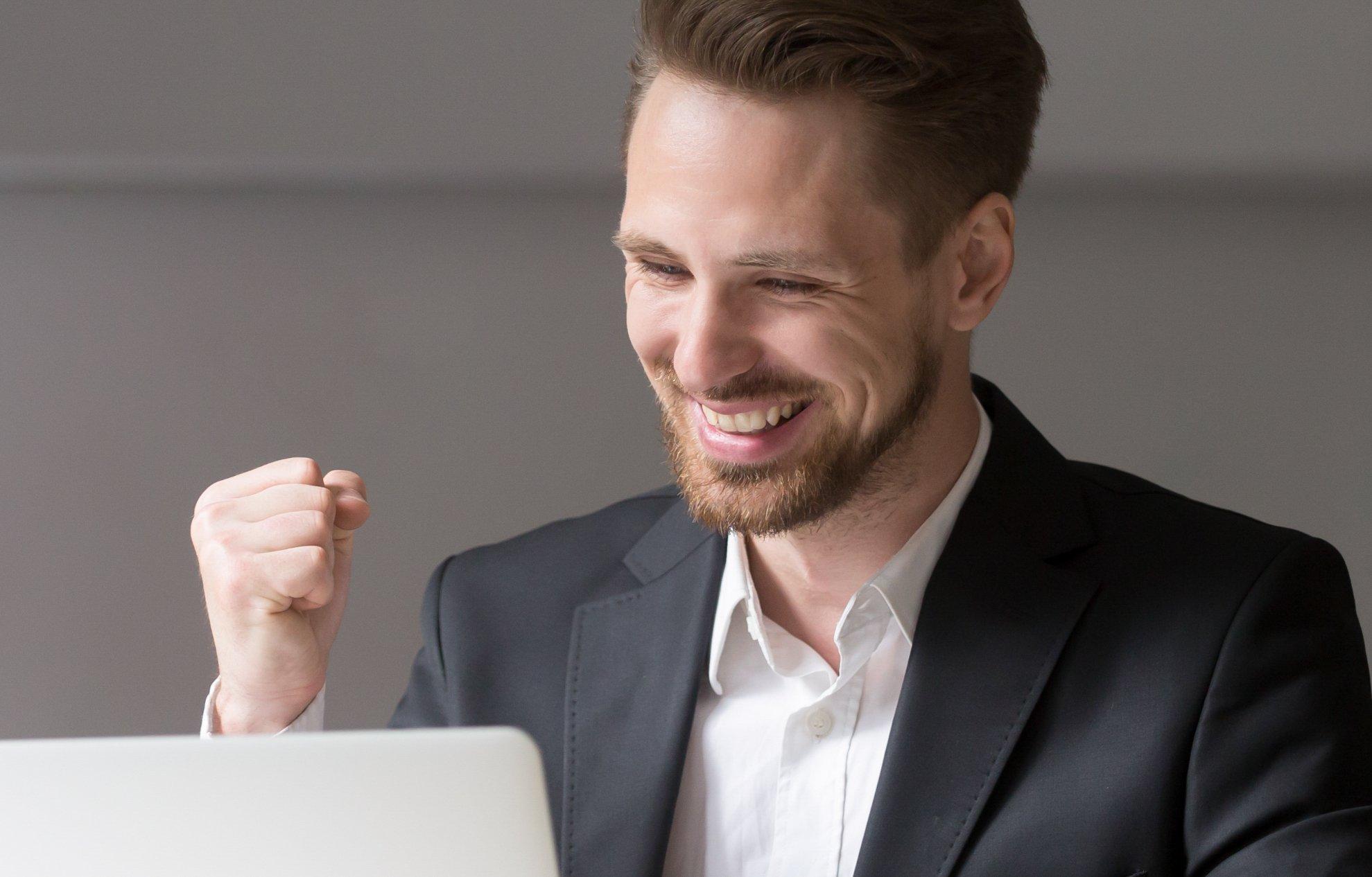 A happy man at his computer